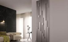 Особенности и достоинства вертикальных радиаторов отопления